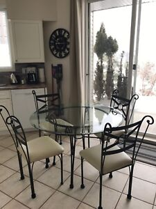 Glass table with four chairs