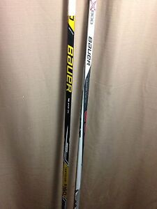 2 lightly used  Senior hockey sticks (both left)
