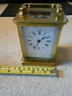 Carriage Clock with Key. Working keeping reasonable time local adjustment.