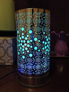 Brand new Chrome colour changing lamp with oil warmer