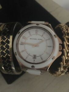 White and Rose Gold Michael Kors watch $59
