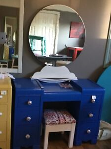 Blue vanity with mirror and stool