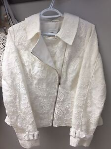 white lace coat- perfect for a bride:)