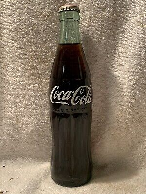 FULL 12oz COCA-COLA TRANSITION ACL AND EMBOSSED SODA BOTTLE