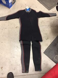 Men's Sequest  med two  pc diving wet suit in good condition.