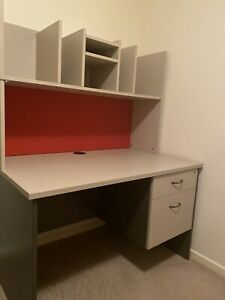 Desk with pin board and shelves