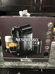 New Nespresso machine with milk frother and free coffee mug