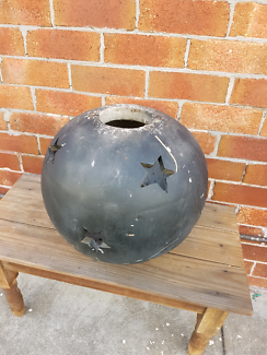 Terracotta sphere with star shaped holes great for a light