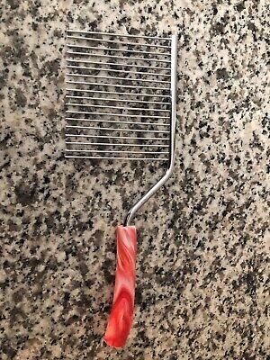 Vintage Red Swirl Plastic Handle Cake Breaker Comb Knife