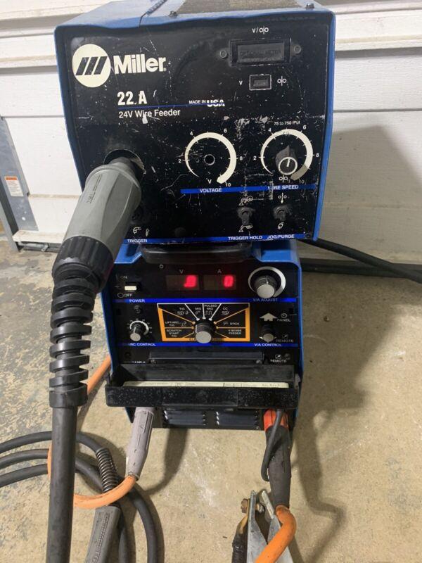 miller xmt 304 cc/cv welder with 22a wire feeder