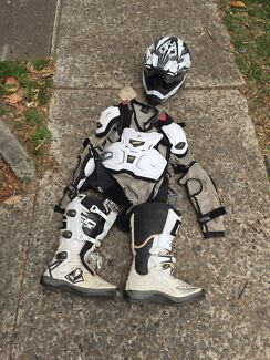 Dirt bike motorbike protective gear boots too and helmet