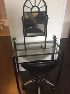 Vanity and modern black swivel chair