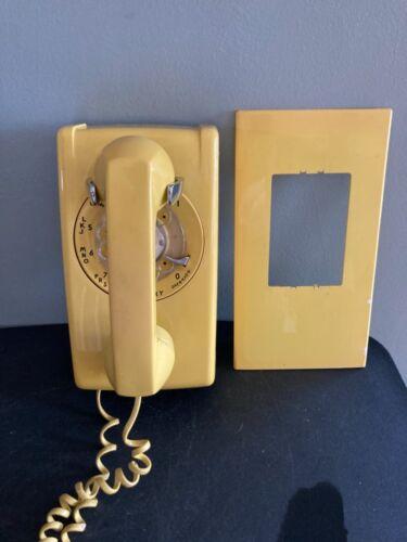 Vintage yellow rotary telephone,1970s