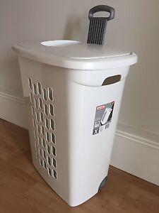 Brand new laundry hamper on wheels with handle