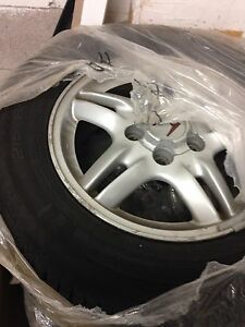 Five Honda CR-V Alloys with tires mounted 215/65R15 $500 OBO