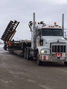 Farm equipment hauling and towing ( Landoll RGN )