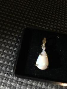 White opal set in 14k gold w diamond