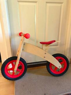 Red balancing bike in good condition