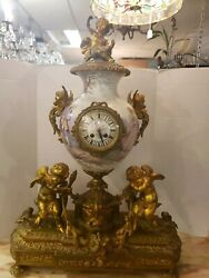 Vintage  French ormulo Sevres rococo style gilt bronze mounted porcelain clock