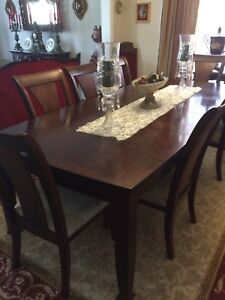 Dining table with 7 high back chairs all from Leon