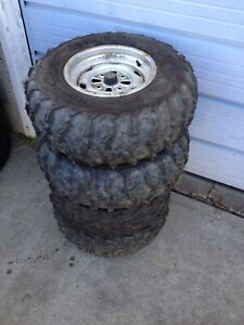 4 studded quad tires on rims- as is (25 10R12)