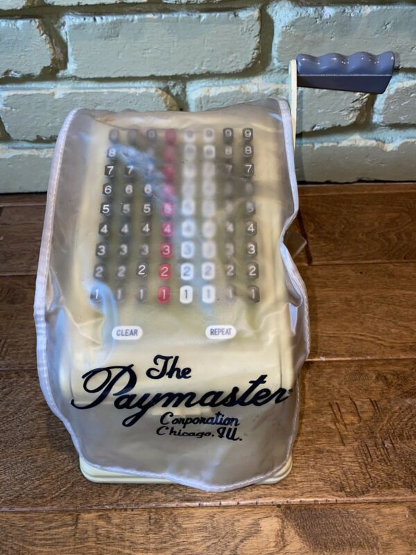 Paymaster Series 7000 Check Writer in color with locking key to lock