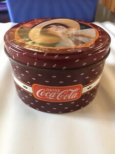Coke and Pepsi Collector Tins