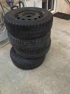 4 good BF Goodrich winter tires on rims