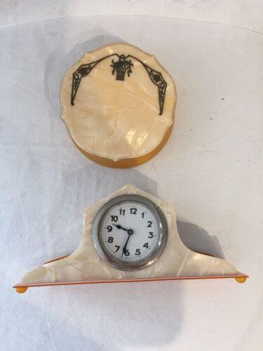 Vintage cream colored celluloid clock and vanity dresser powder jar box.