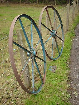 LARGE PAIR OF ANTIQUE IRON WHEELS AND NAME PLATE