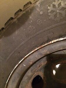 Set of 4 snow tires ON rims (185/65 R14)