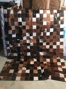 Cow hide patch work rug