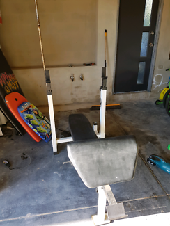 Bench press equipment with leg extension and bicep curl