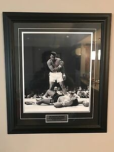 Muhammad Ali V Sonny Liston framed glass picture.
