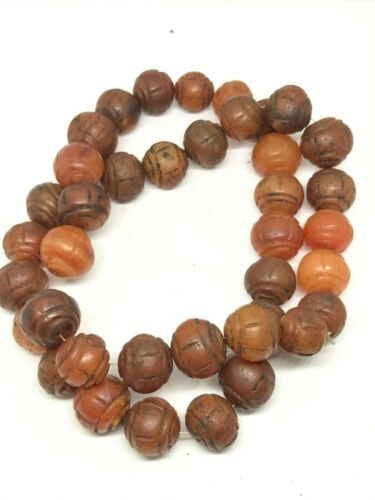 A collection of carnelian beads
