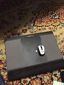 Wireless mouse with laptop stand.