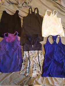 5 ladies Lululemon tops and 1 Athleta top. Coniston Wollongong Area Preview