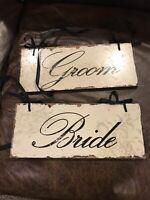 Bride and Groom signs.