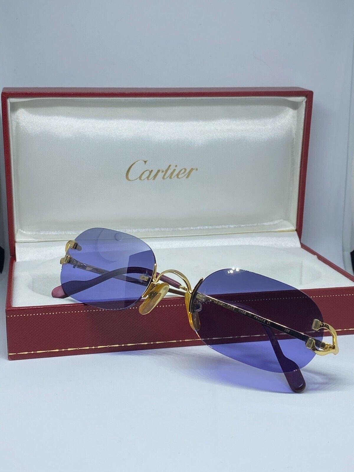 Lunettes de soleil cartier c decor avec boite cartier monture or verre violet