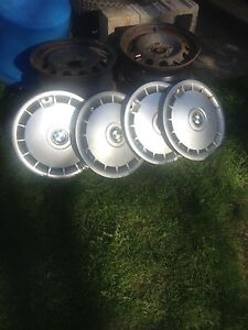 15 inch bmw factory steel rims and wheel covers