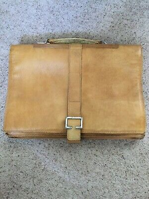 hidesign leather briefcase. Tan. Used. Flap over with buckle closure