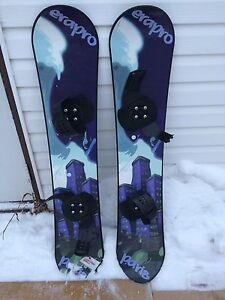Two plastic beginner snowboards