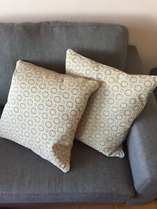 4 grey and beige couch pillows