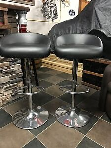 2 Chrome and Leather bar stools with gas shocks