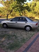 Ford laser 2002, Auto, AC, Expires April 1, 2 new tires Queens Park Canning Area Preview