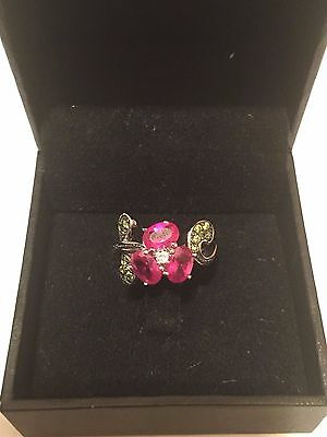 lady's ring sparkling magenta flower with green leaves new
