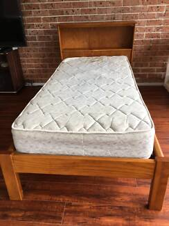 Single timber bed with mattress, storage bed head