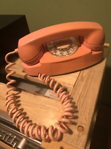 Vintage collectible pink rotary dial phone