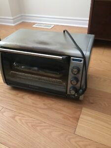 Gray toaster oven works well