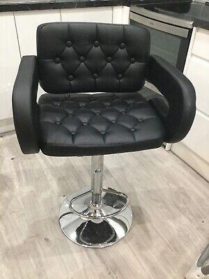 A relatively new Black swivel bar stool